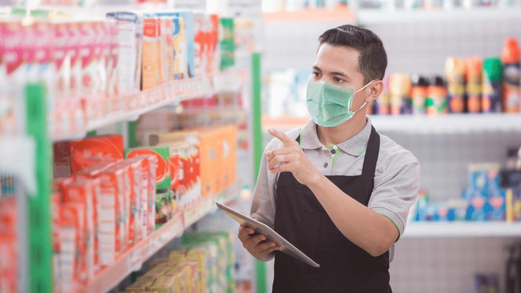 Retail employee wearing mask